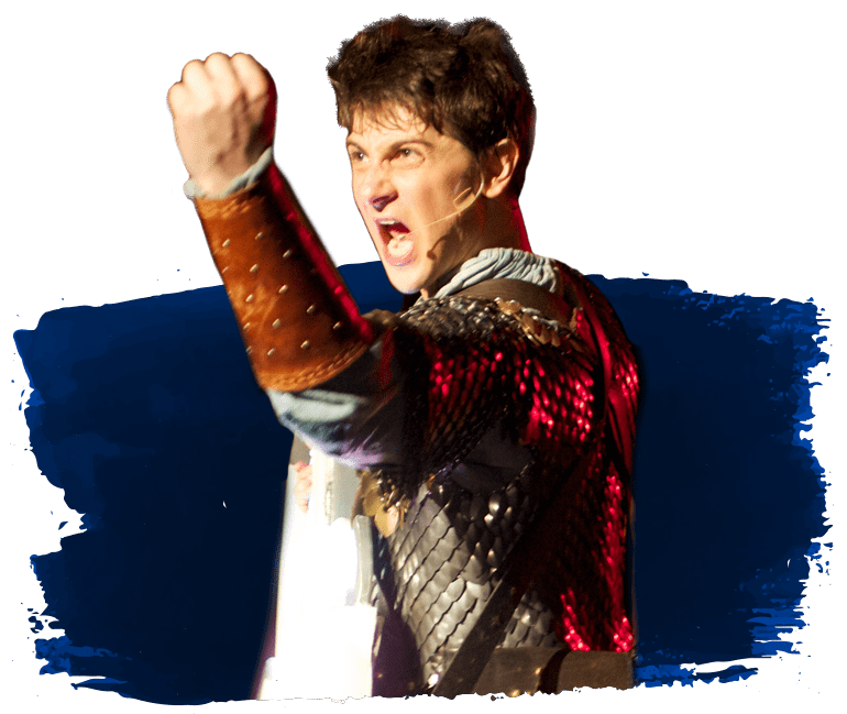Actor Chris Kyrsztofiak as the character Benedon, hero of 2014's rock opera Grundlehammer. Chris has his fist raised and mouth agape in a righteous manner and is wearing some sweet scale mail armor.