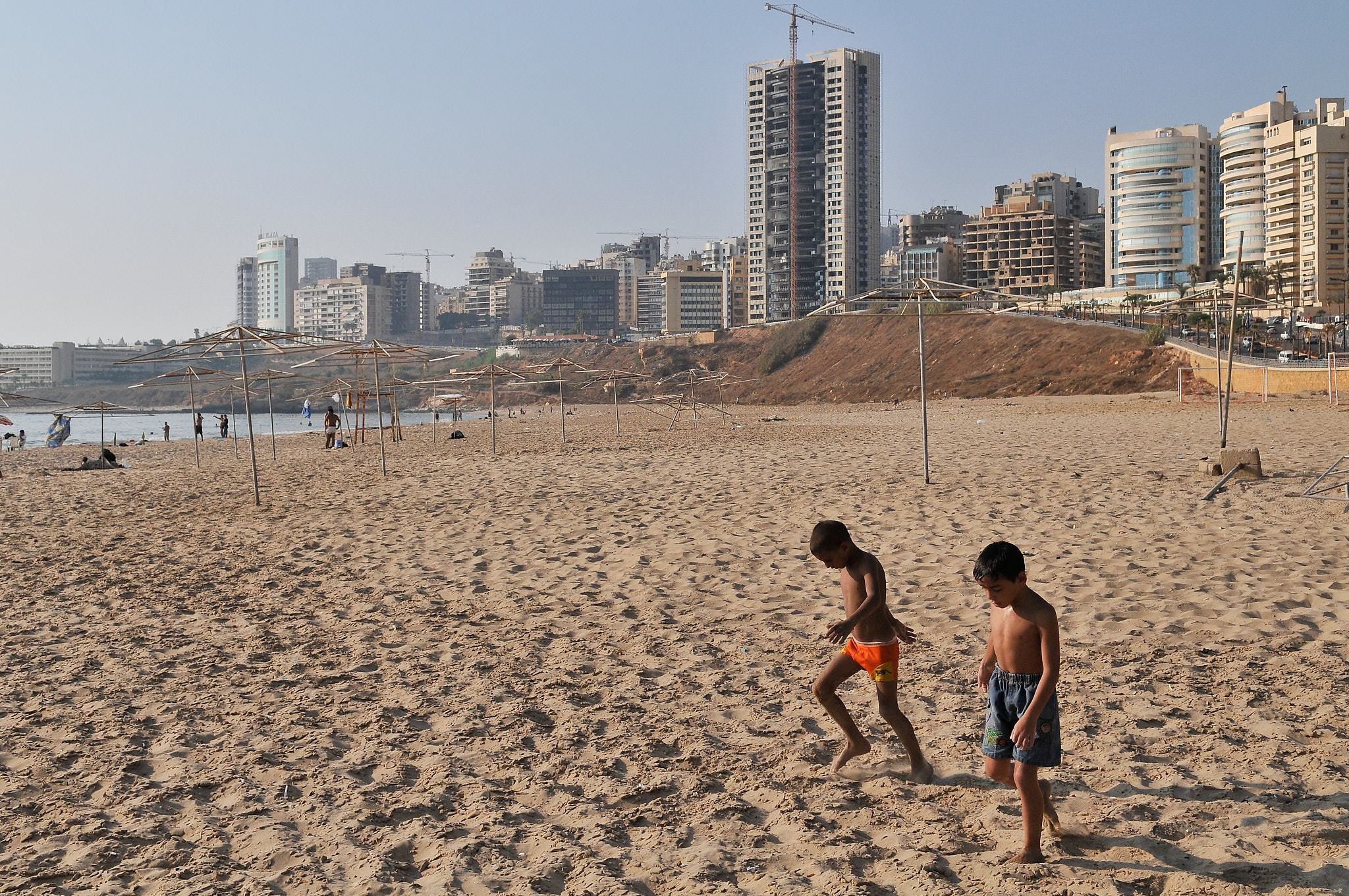 Two boys enjoys a summer afternoon on Ramlit El Bayda's neglected beach, Beirut's only remaining free public beach. Beirut, 2009.