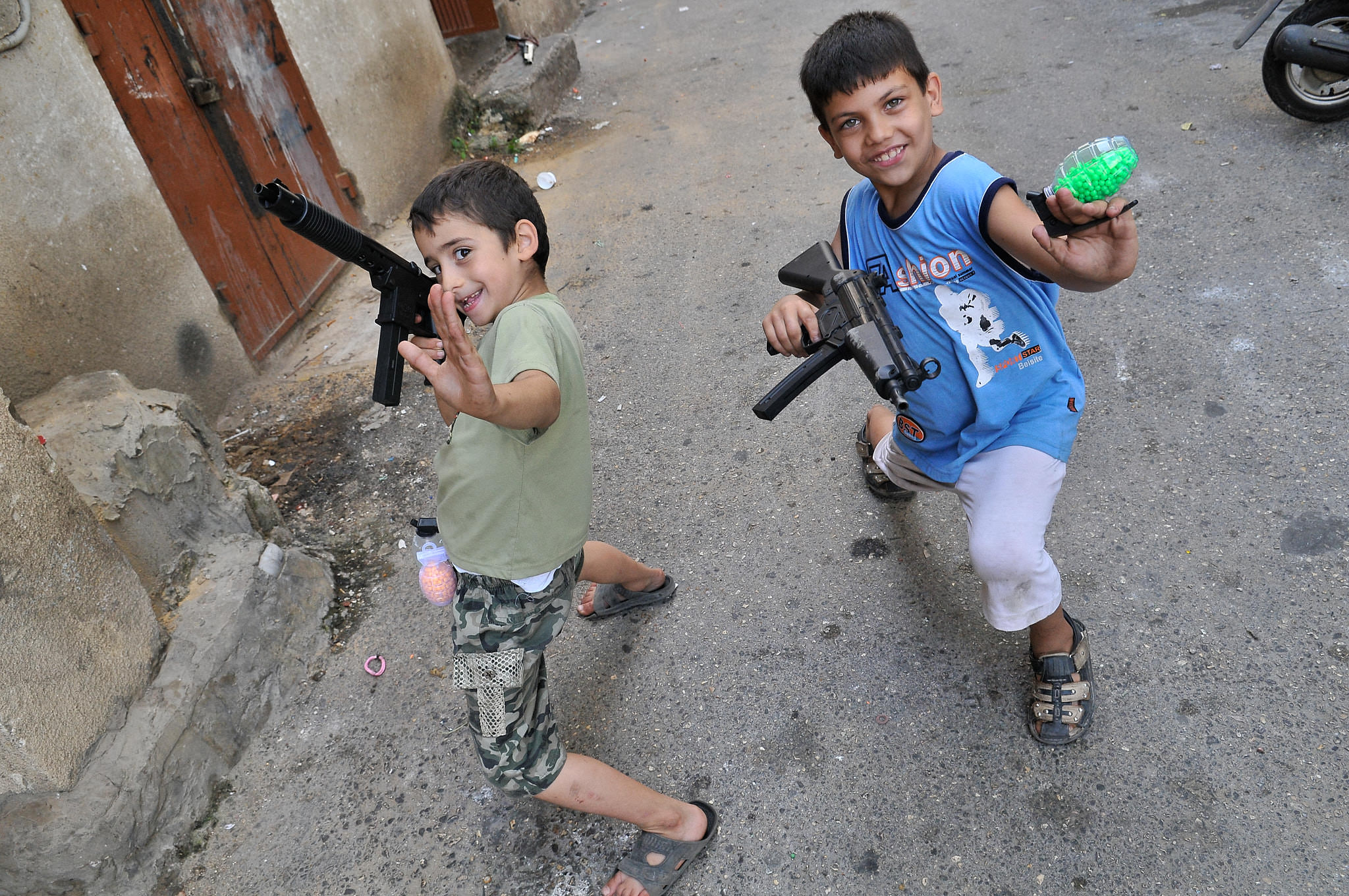Two boys play war on the streets of Ras El Nabeh, an area that has seen numerous outbreaks of violence over the years. Beirut, 2009.