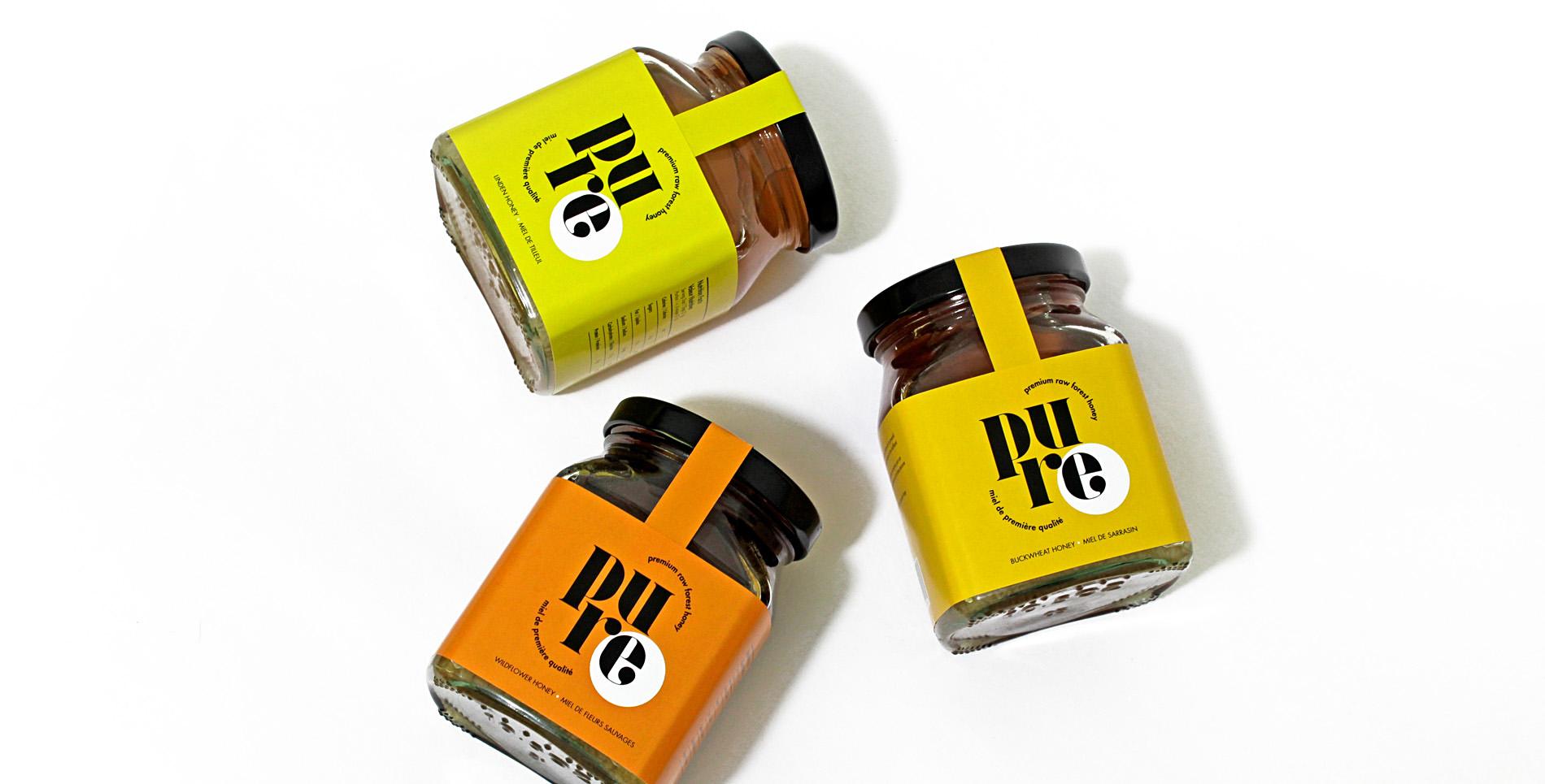 Pure honey bottles birds-eye view