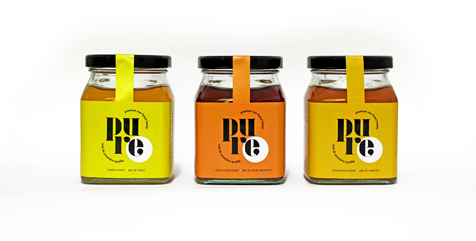 Three Pure honey bottles side by side