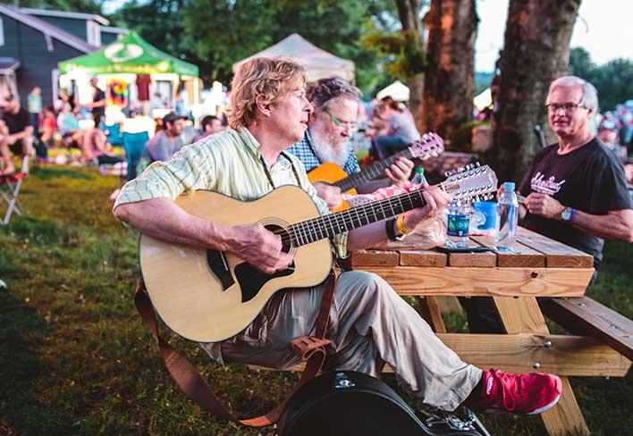A man playing guitar