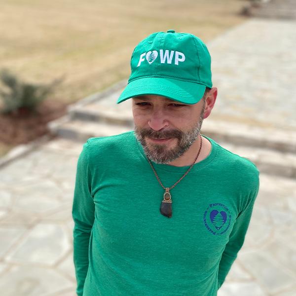 A person wearing Friends of Warner Parks Baseball Cap