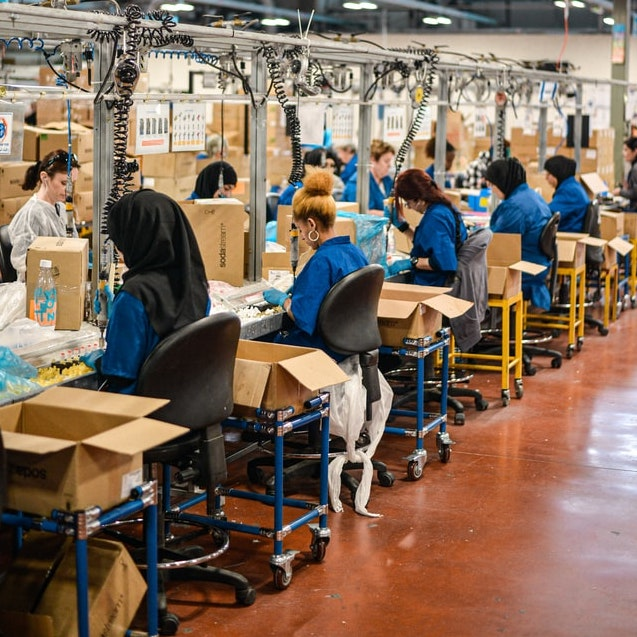 Factory workers assembly line