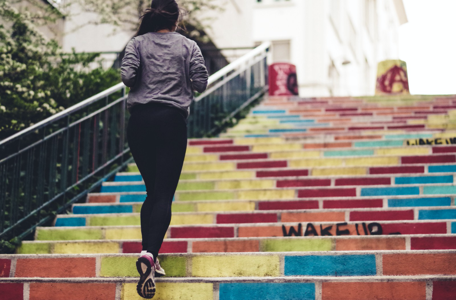 a woman exercising running on the stairs