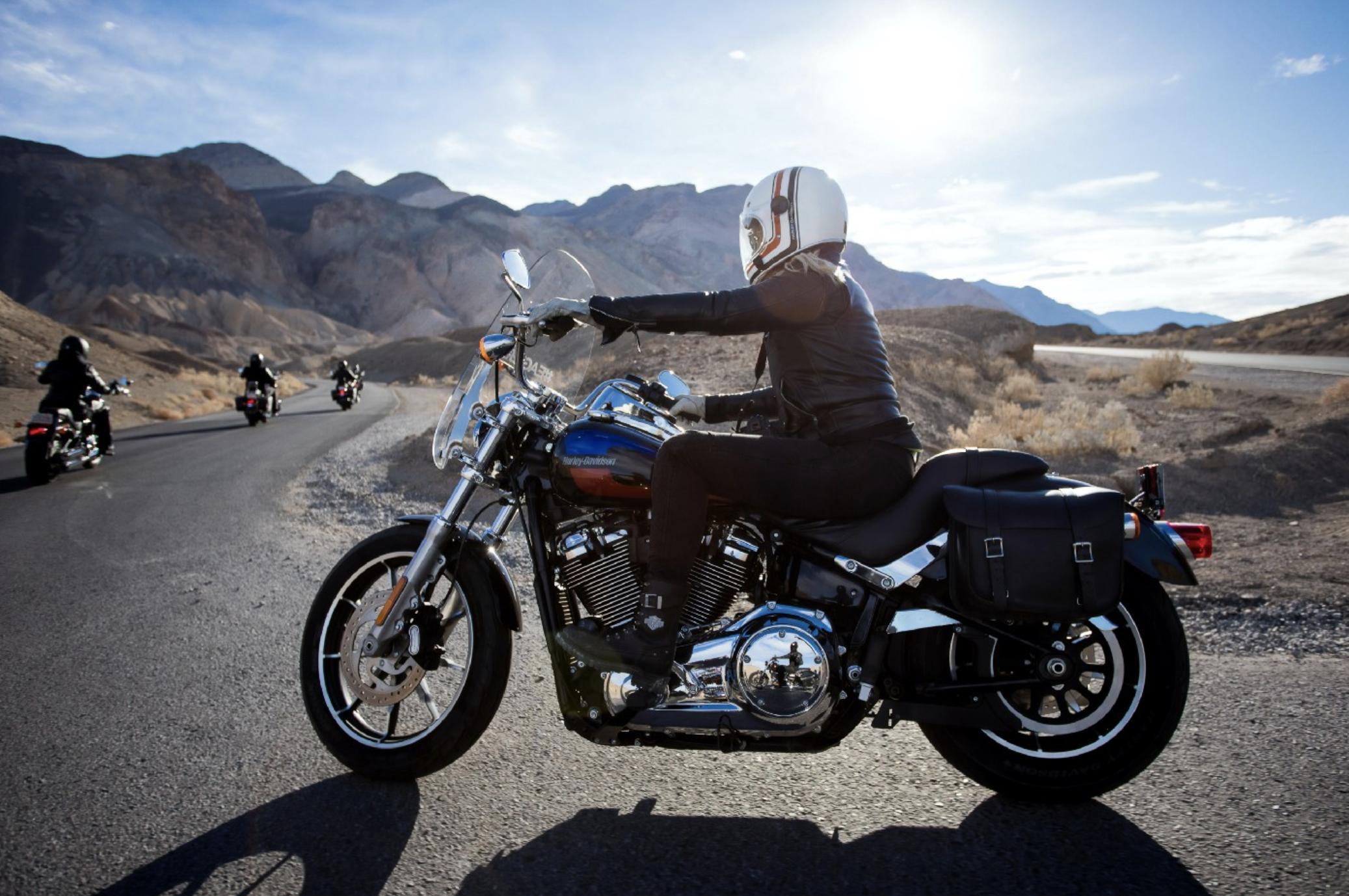 A man driving a Harley Davidson motor