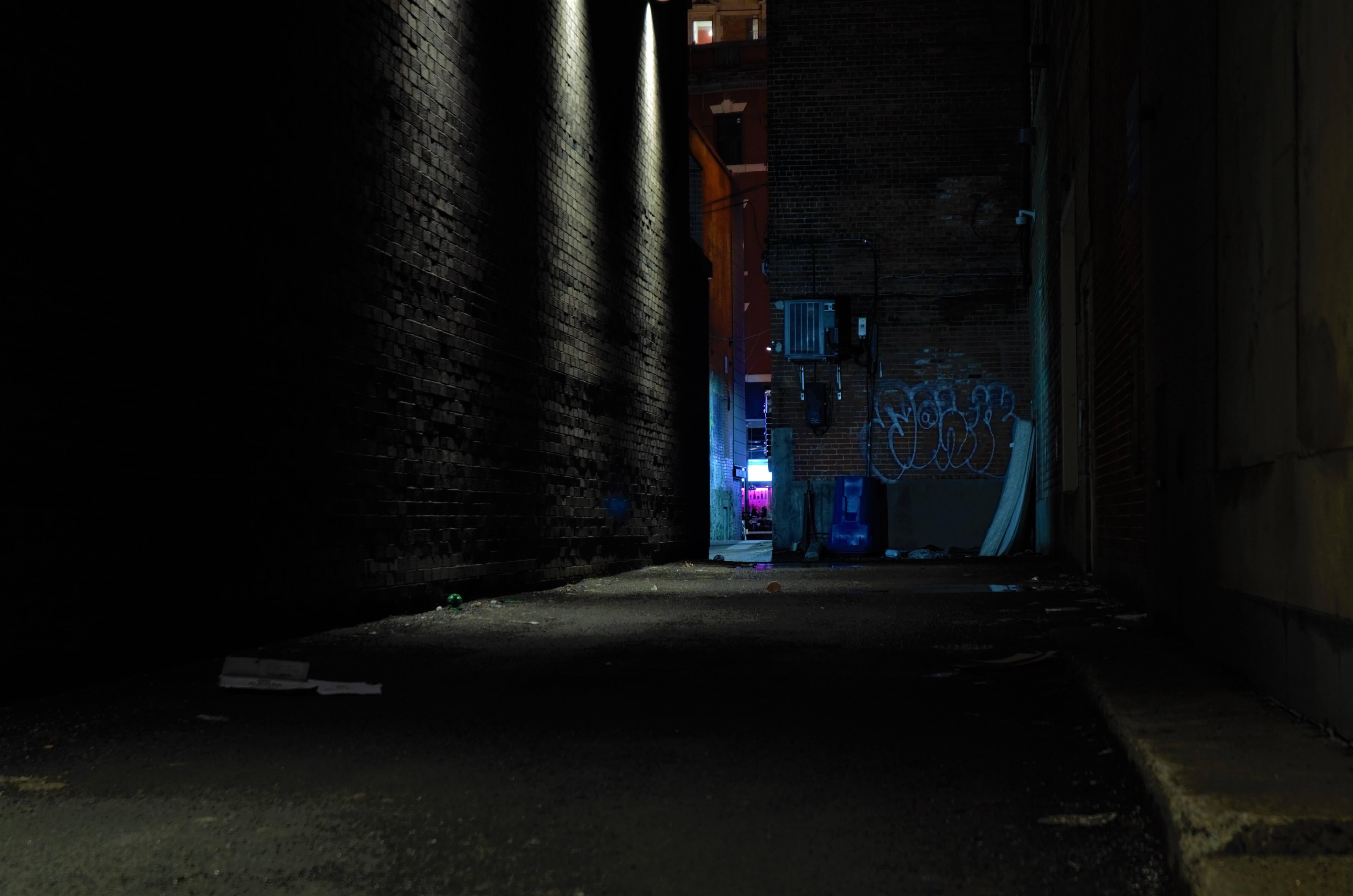 A dim, dark alleyway