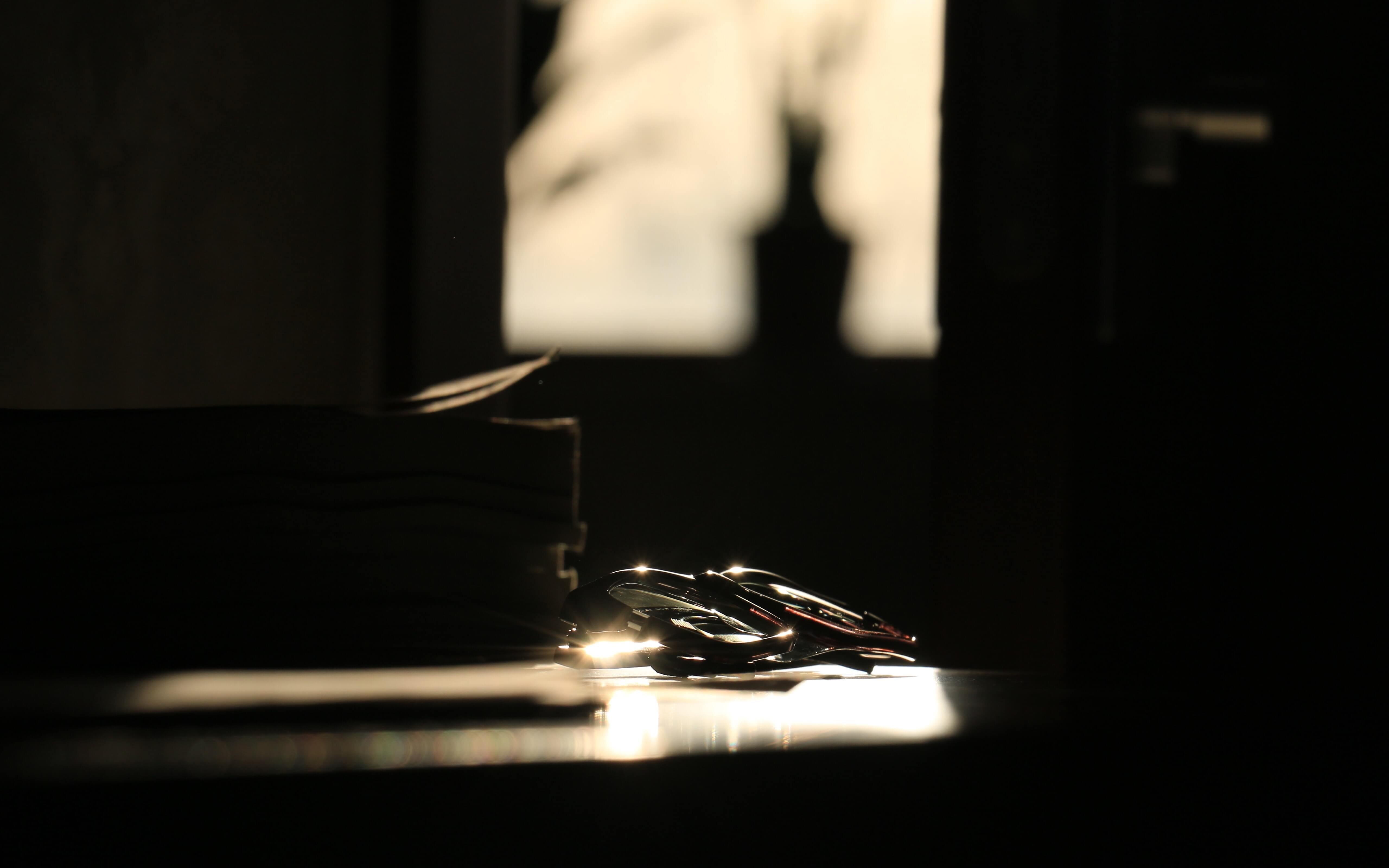 Glasses on a table lit by a window from behind