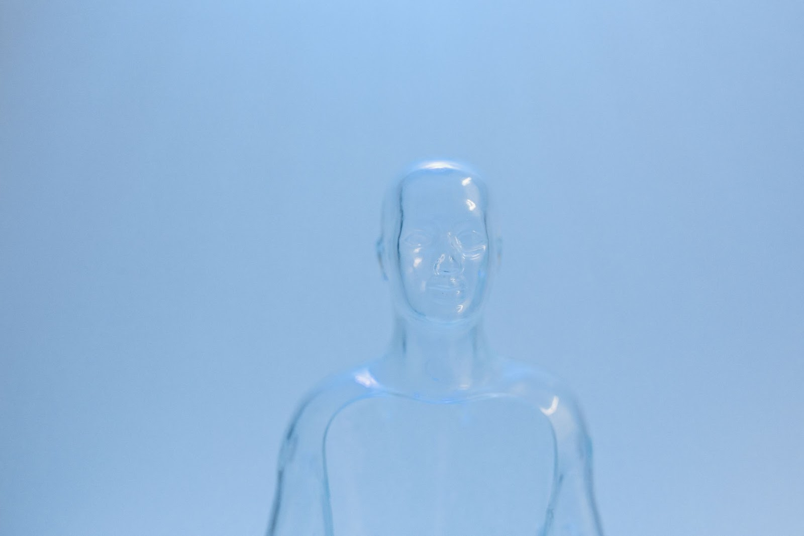 Clear mannequin standing.