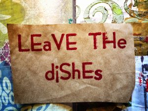 Leave the Dishes in red ink on brown paper from the Slow Dress at PRESS exhibition in 2014
