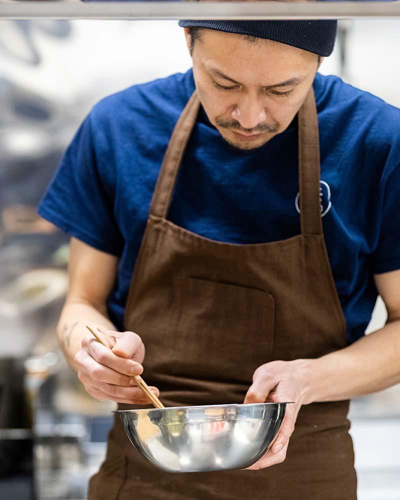 Chef Yuji preparing food in the kitchen
