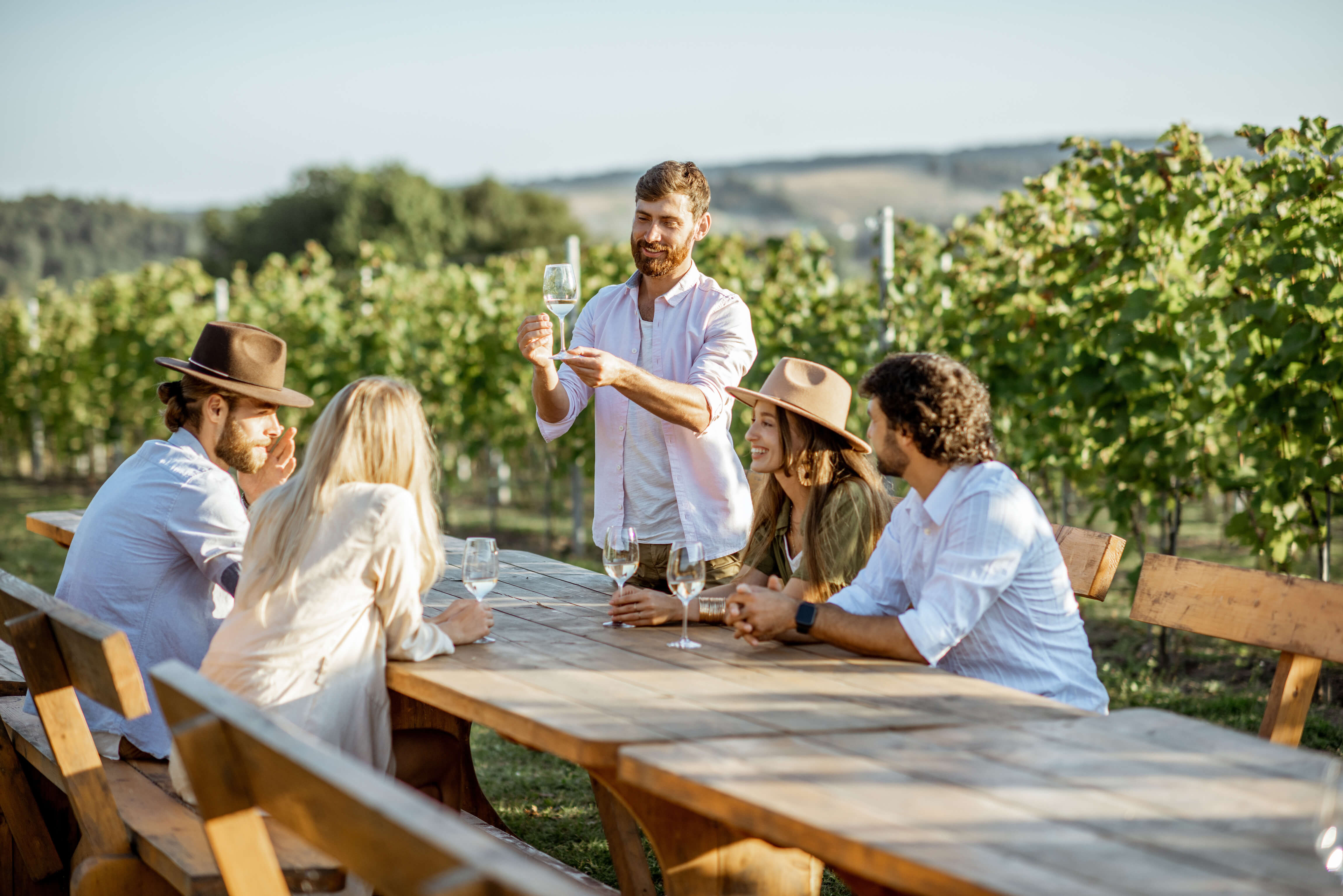 New Zealand locals enjoying wine in the sunshine