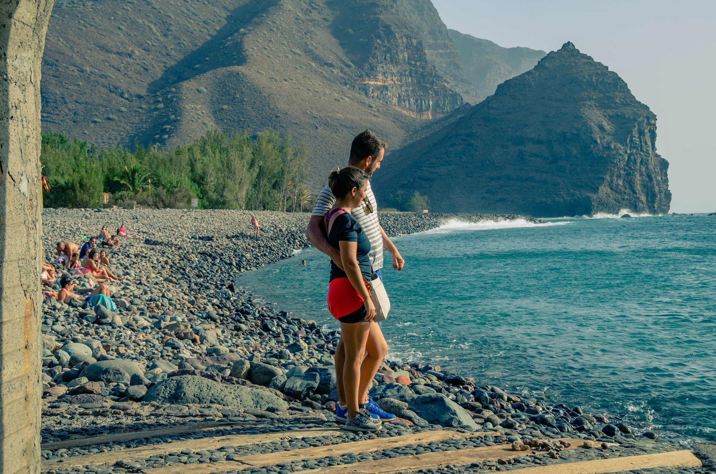 Couple enjoying views at Playa de La Aldea de San Nicolas, Gran Canaria