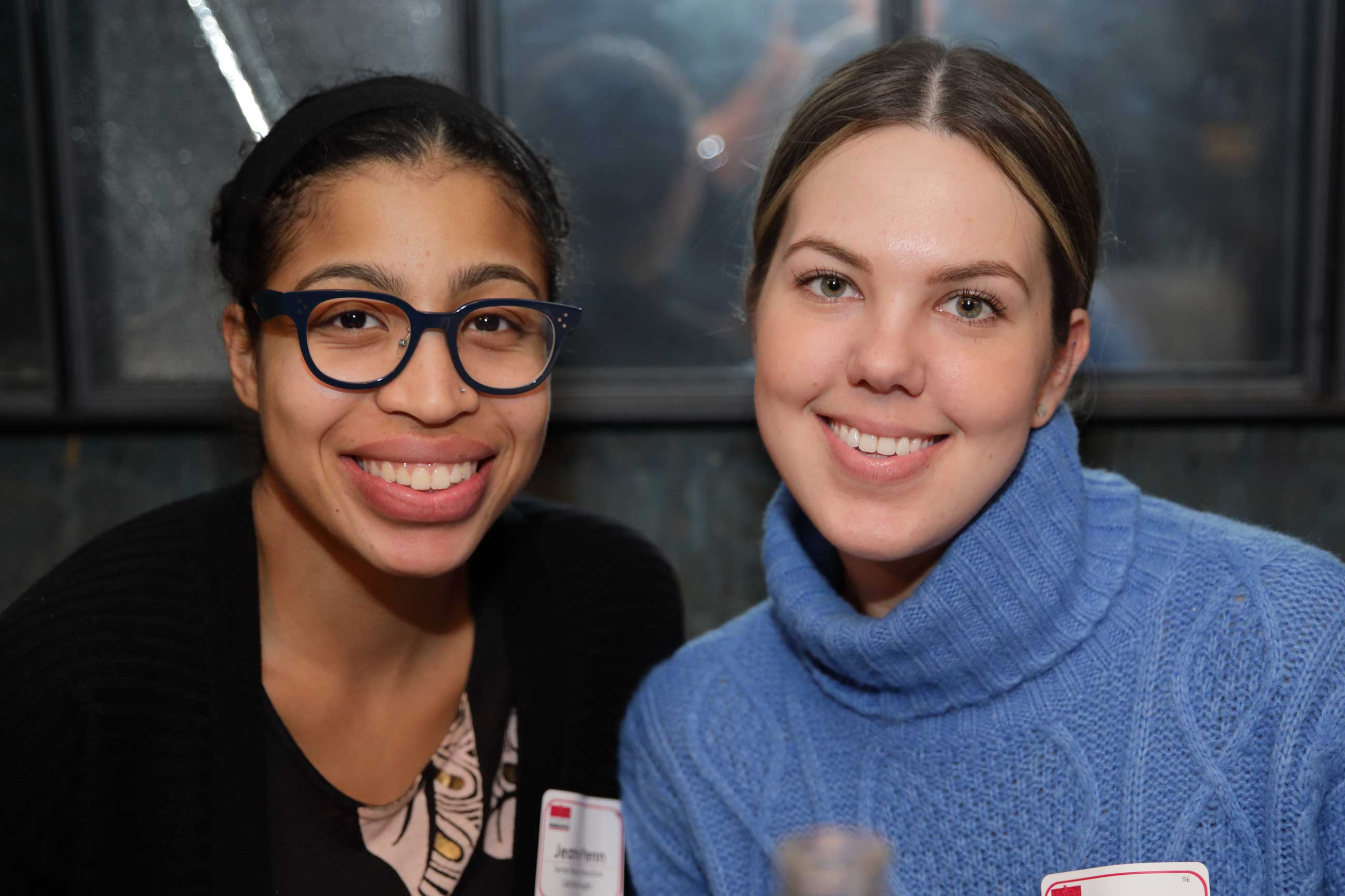 Two women smiling at a Women in Research event