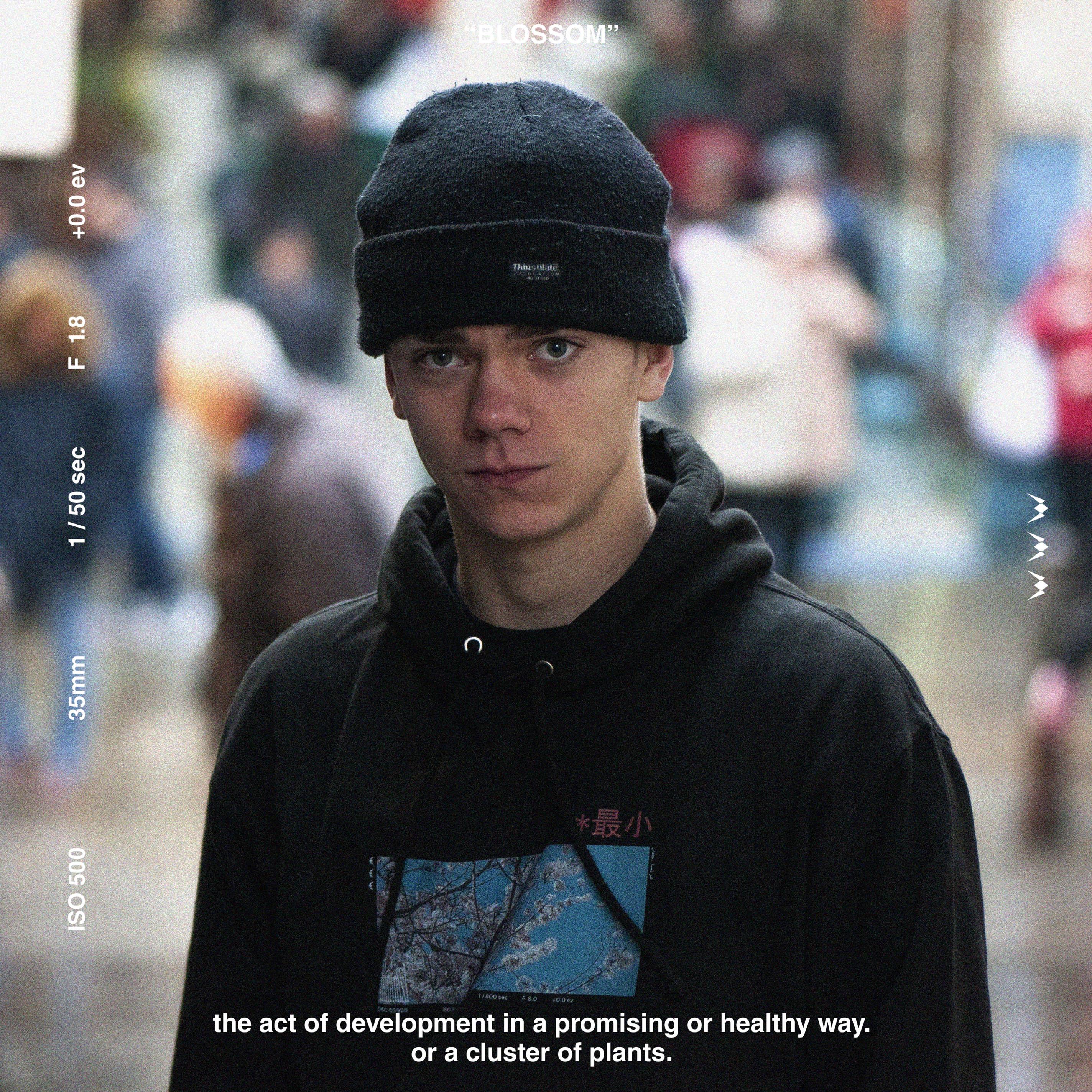 A person wearing minimxl hoodie