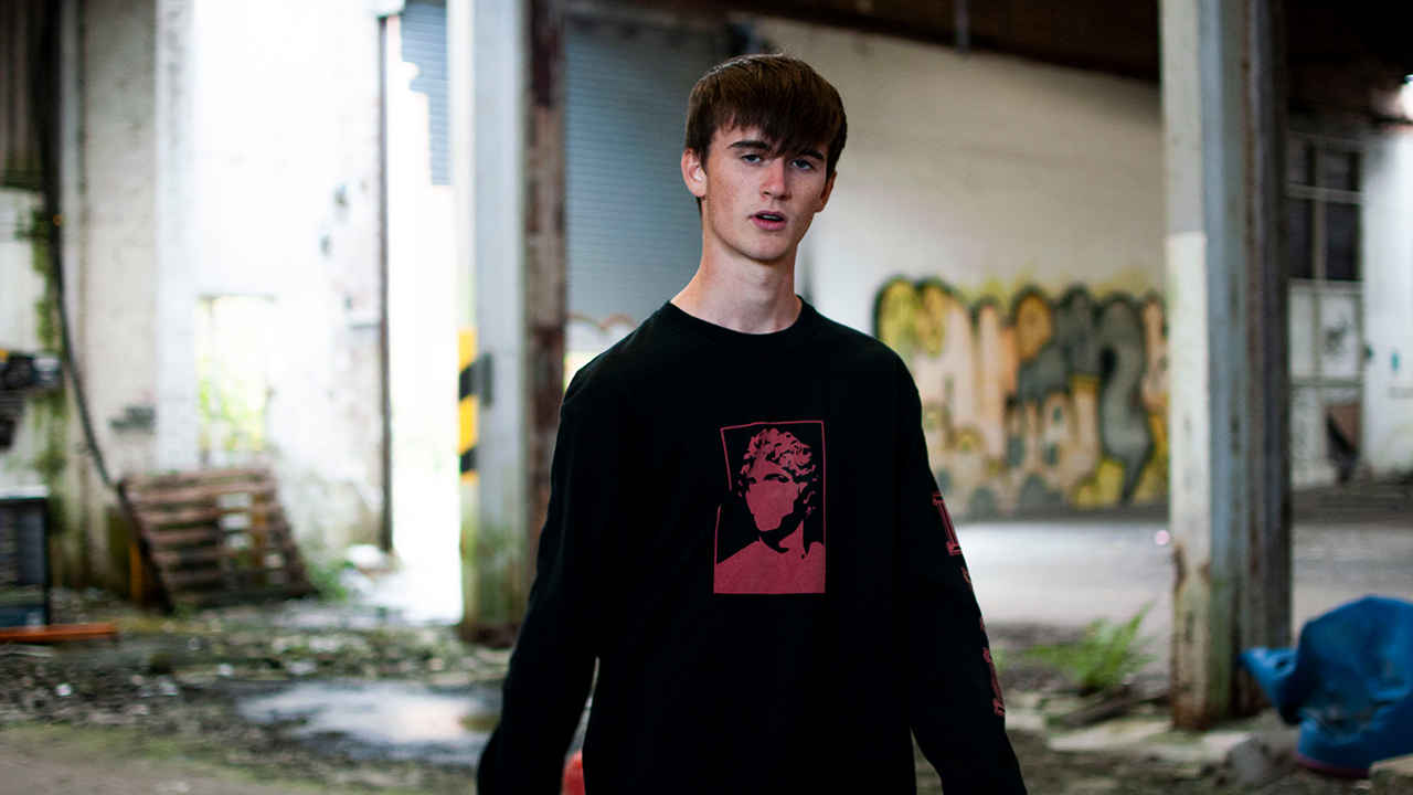 Man wearing obsident clothing
