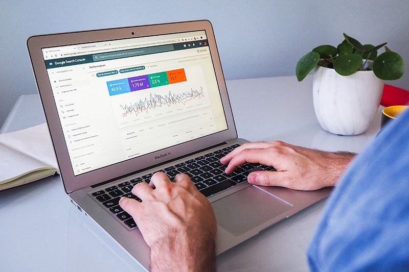 Man using Google Search Console on a laptop.