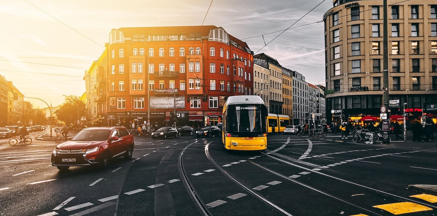 Photo of the intersection at Rosenthaler Platz with a cars and a tram