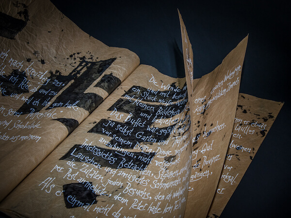 Photo of a book with brown paper and black and white letterings.