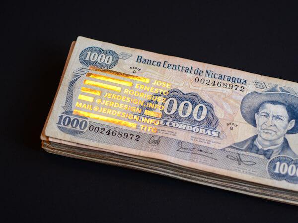 Photo of my business card made of Nicaraguan bills