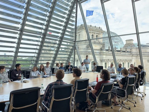 Photo of the 2019 fellows during a meeting with the Reichstag in the background