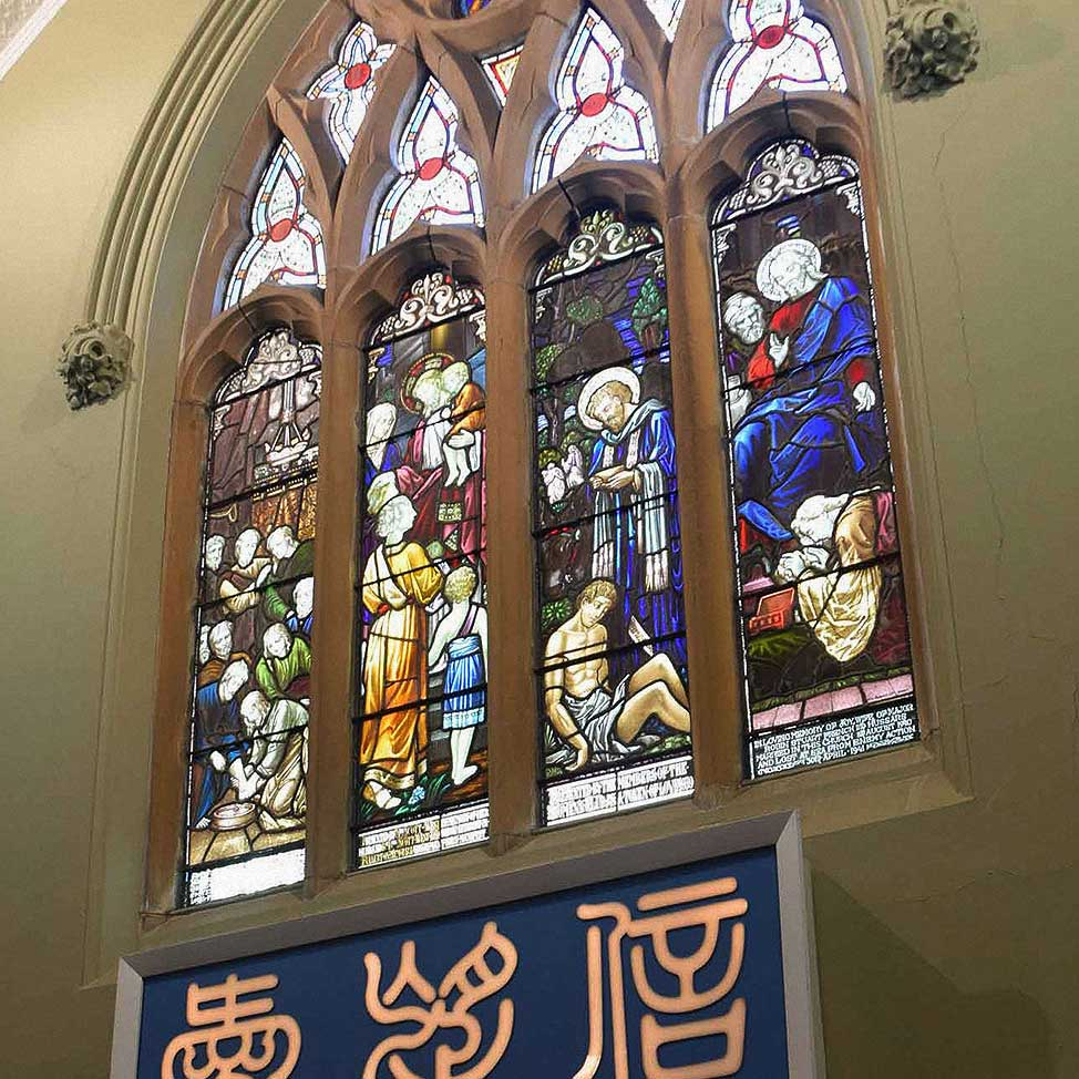 The stained glass windows of CPC's auditorium.