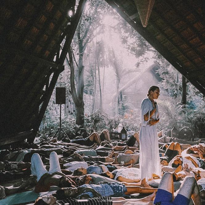 Woman in an ashram meditating breathwork and mindfulness