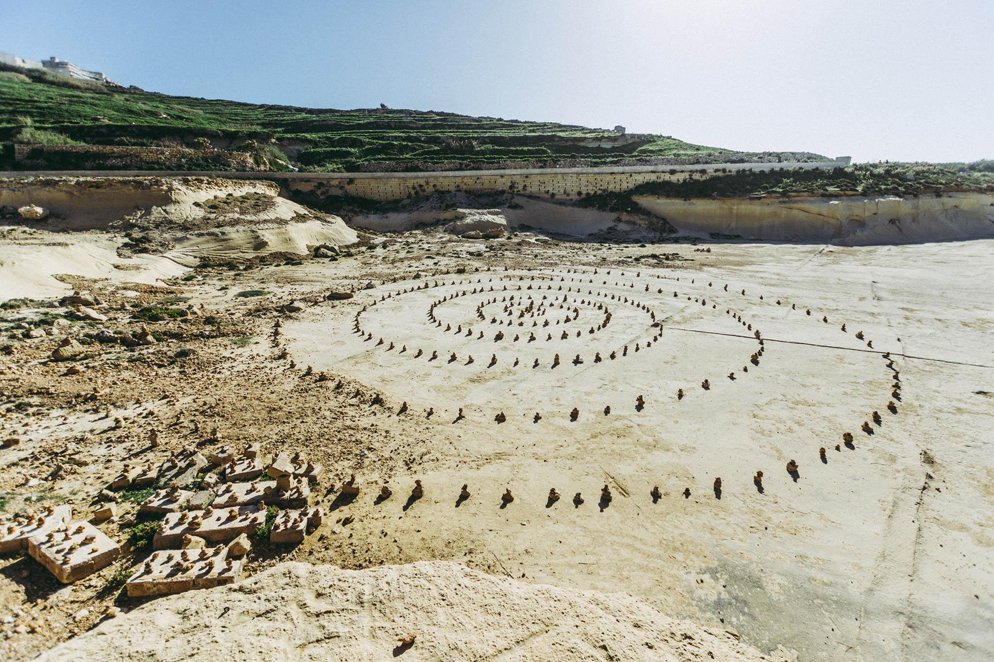 jana sabeth stones on a beach