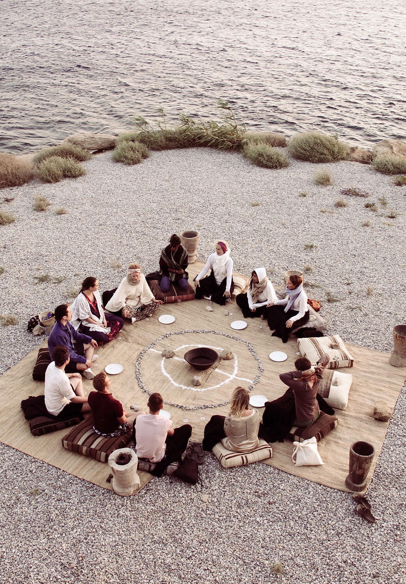 ritual fire bonfire on the beach people in circle doing ritual