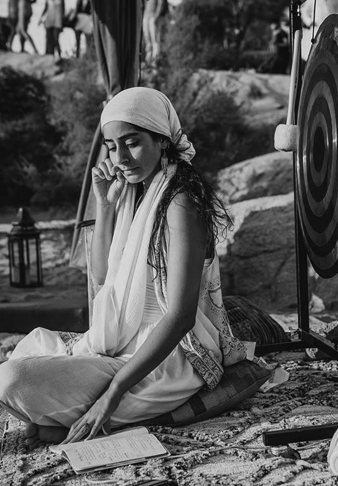woman doing kundalini yoga meditation and breathwork in white
