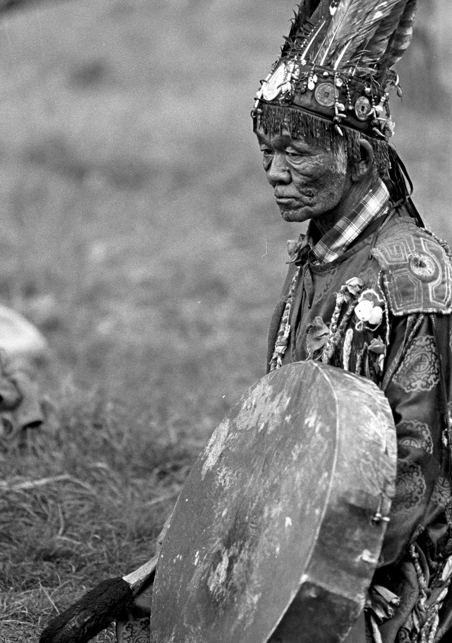 shaman with a drum bones and feathers