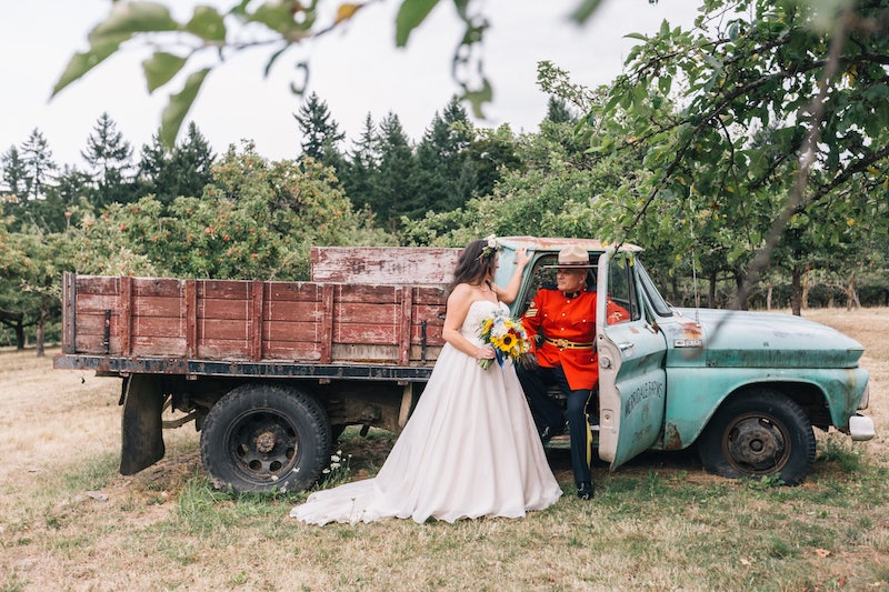 RCMP couple with old chevy truck at merridale wedding venue on Vancouver Island. Taken by Marlboro Wang Photo for Focal bookfocal.com