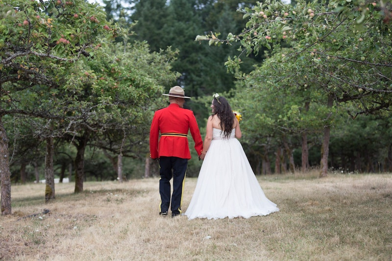 RCMP couple in apple orchard merridale wedding venue on Vancouver Island. Taken by Marlboro Wang Photo for Focal bookfocal.com