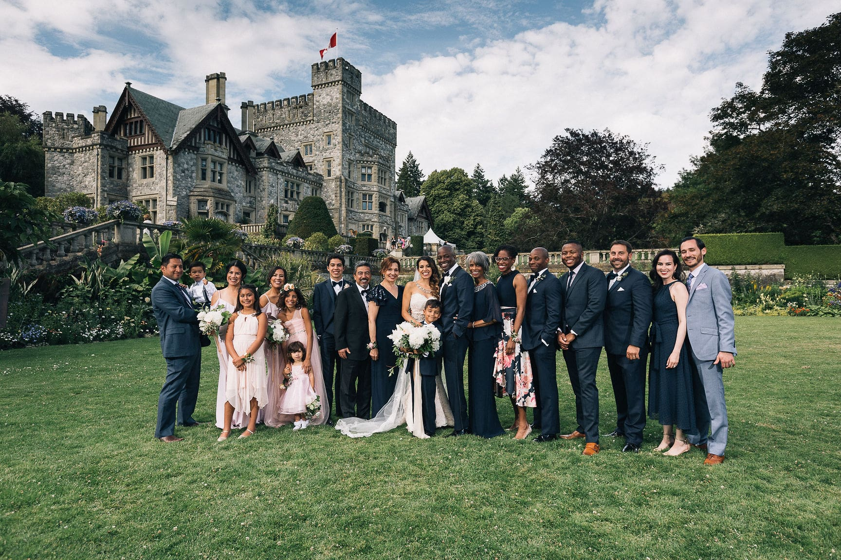Family formal at Hatley Castle Victoria BC bride holding dress, taken by Marlboro Wang Photo for Focal bookfocal.com