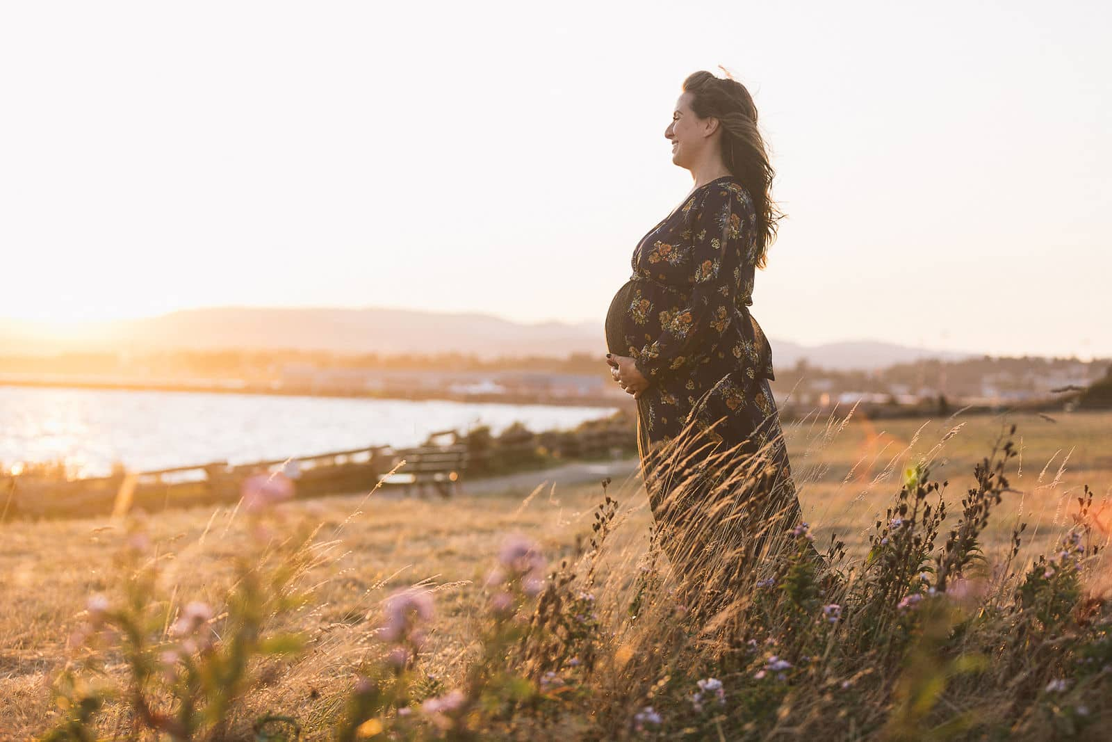 An expecting mother basks in golden hour at Dallas Road in Victoria, BC. Photo by Marlboro Wang.