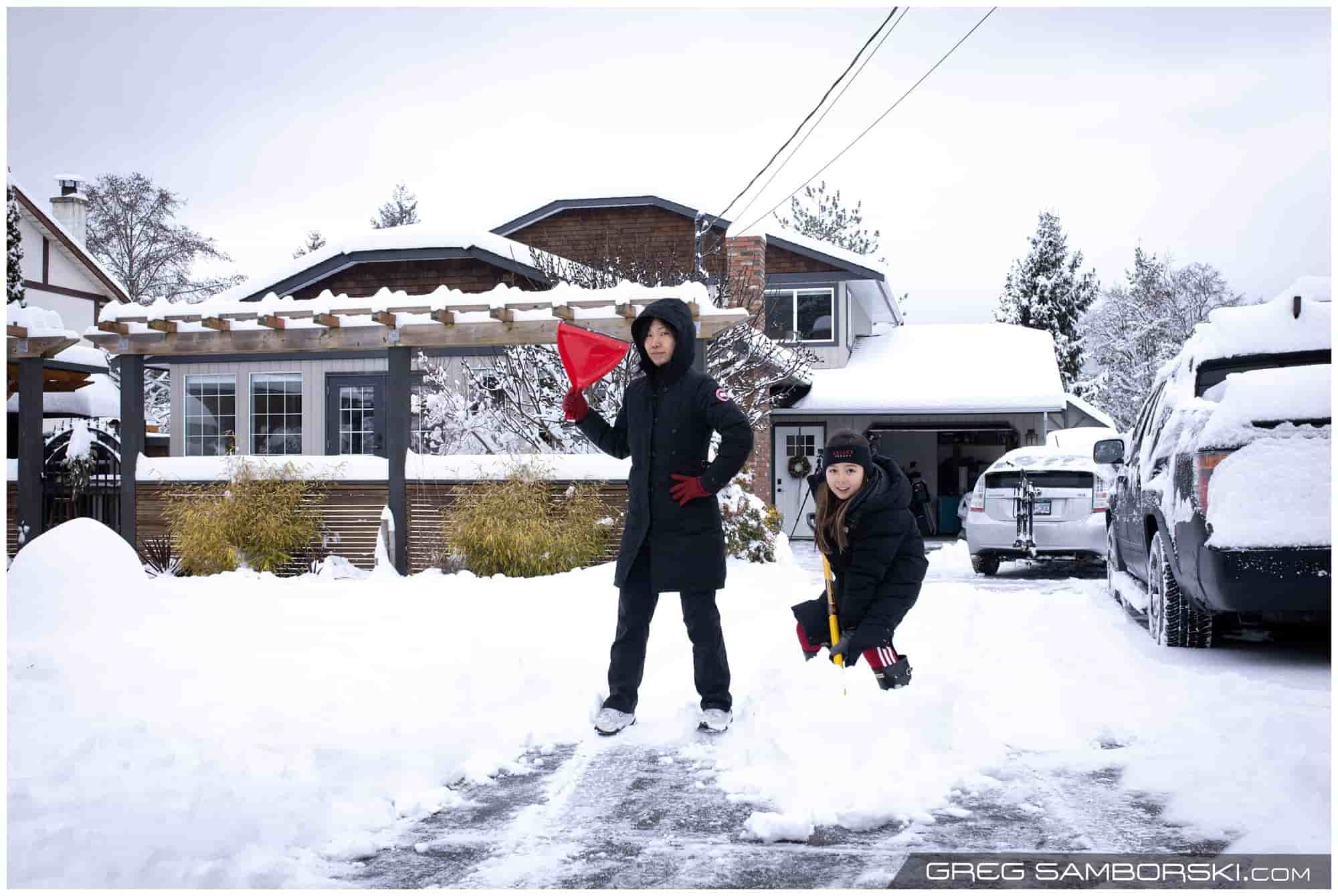 A mother and daughter shovel snow in Victoria, BC.