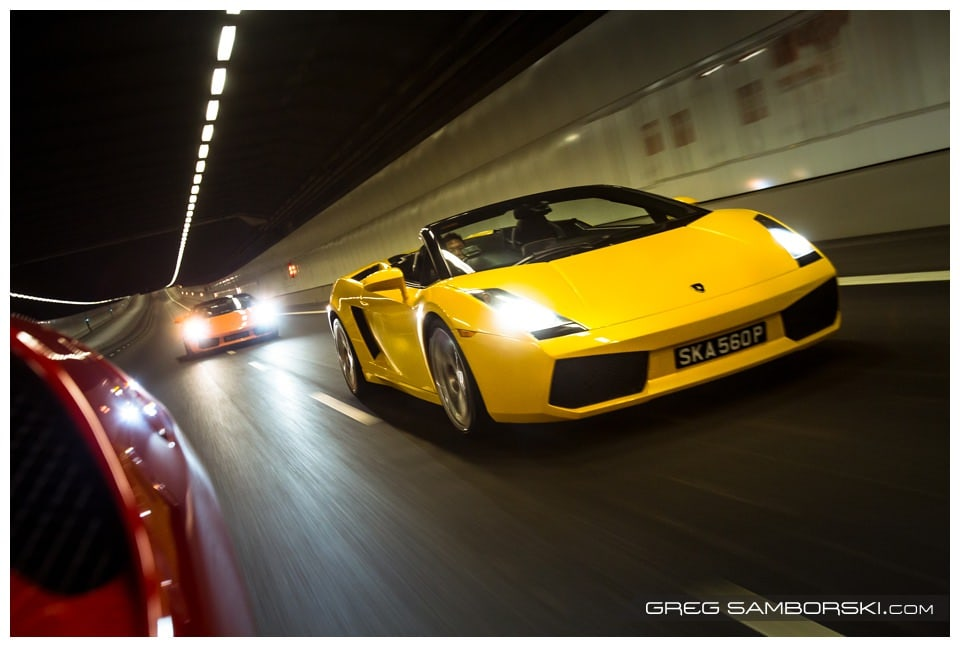 Two Lamborghinis cruise down an empty tunnel in Singapore.