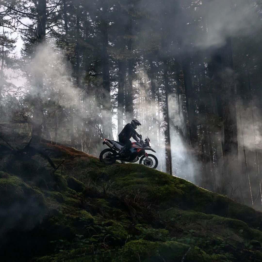 A motorcyclist descends a rocky slope on Vancouver Island.