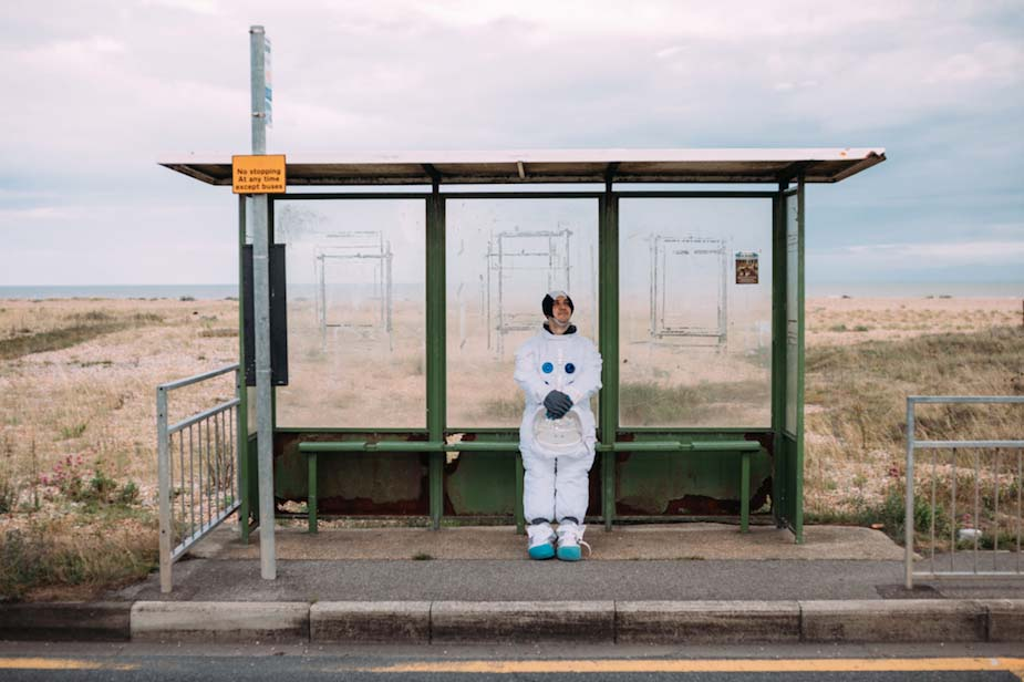 An astronaut waits for the bus. Photo by Tom Leishman