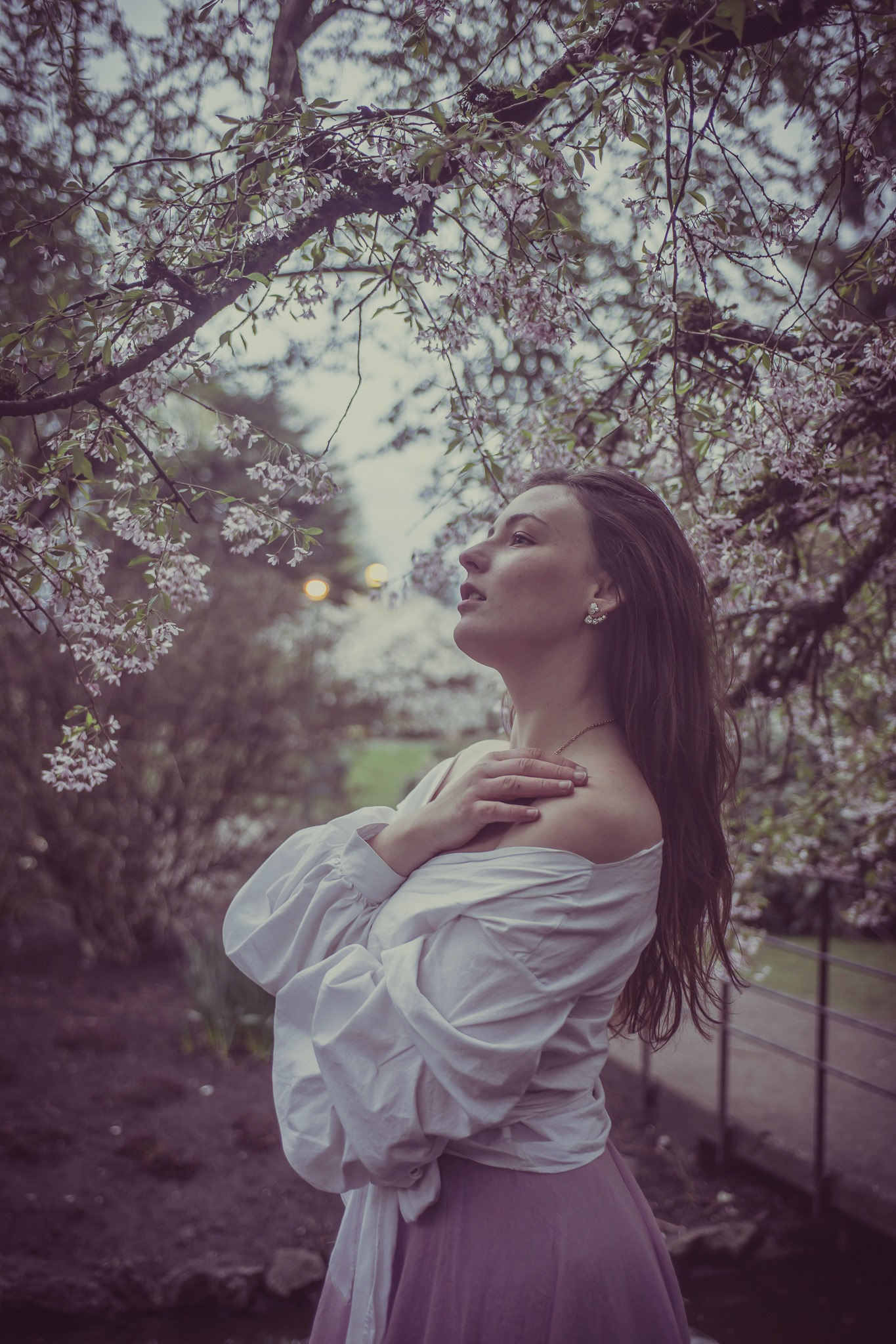 May be an image of 1 person, flower, tree and outdoors