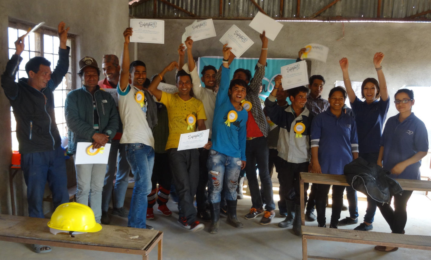 Safety training completed holding up certificates