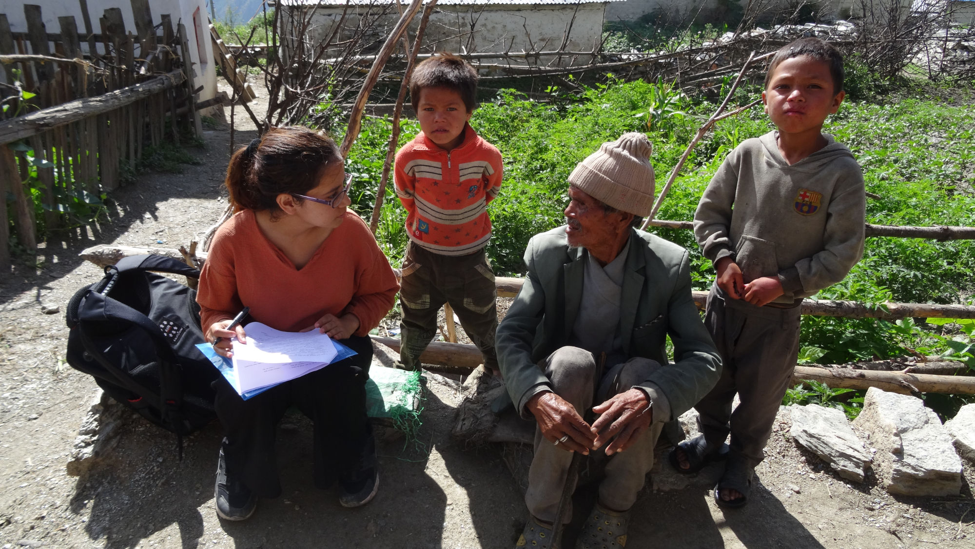 Woman surveying elderly man and two young boys