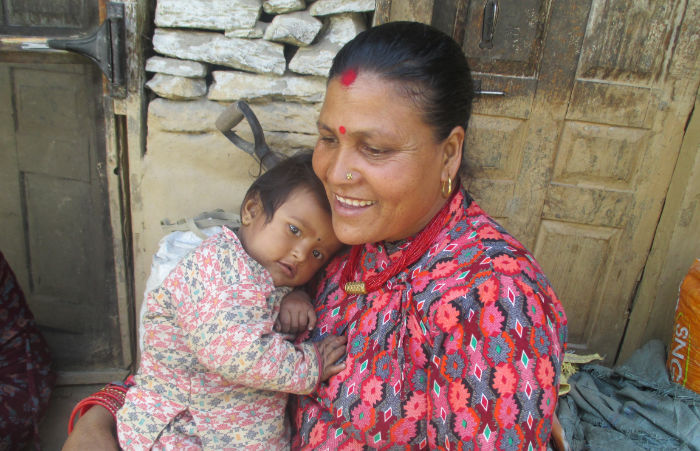 Nepali woman holding baby in her arms