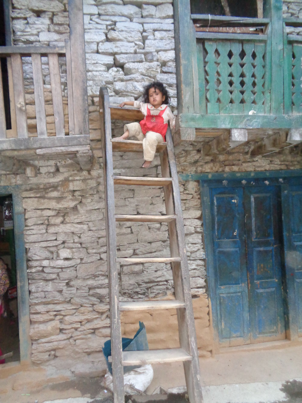 Unaccompanied young child on ladder
