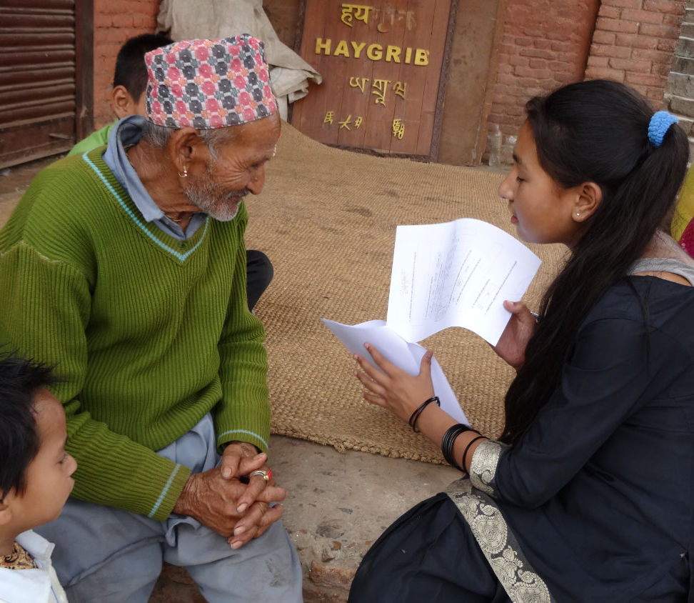 Young woman interviewing elderly man