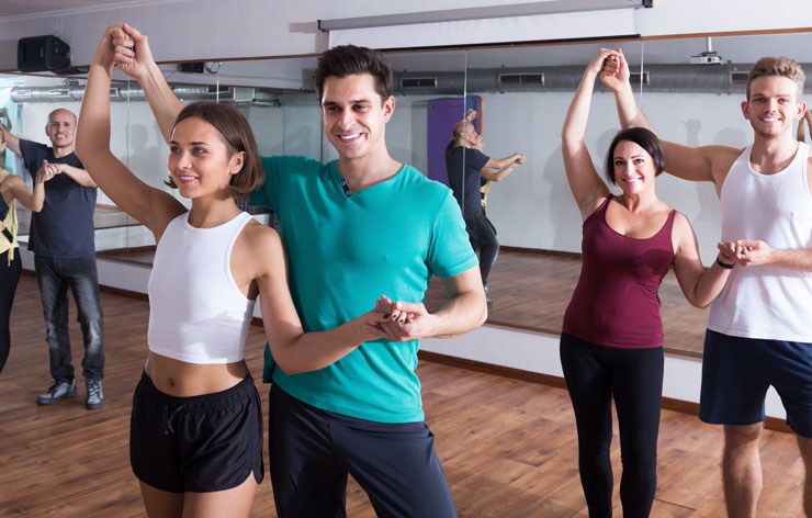 A couple taking a dance class together.