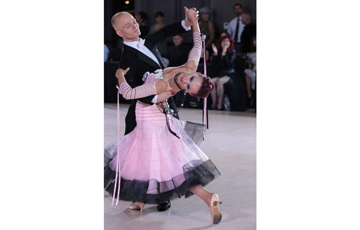 A couple dancing at a ballroom competition.