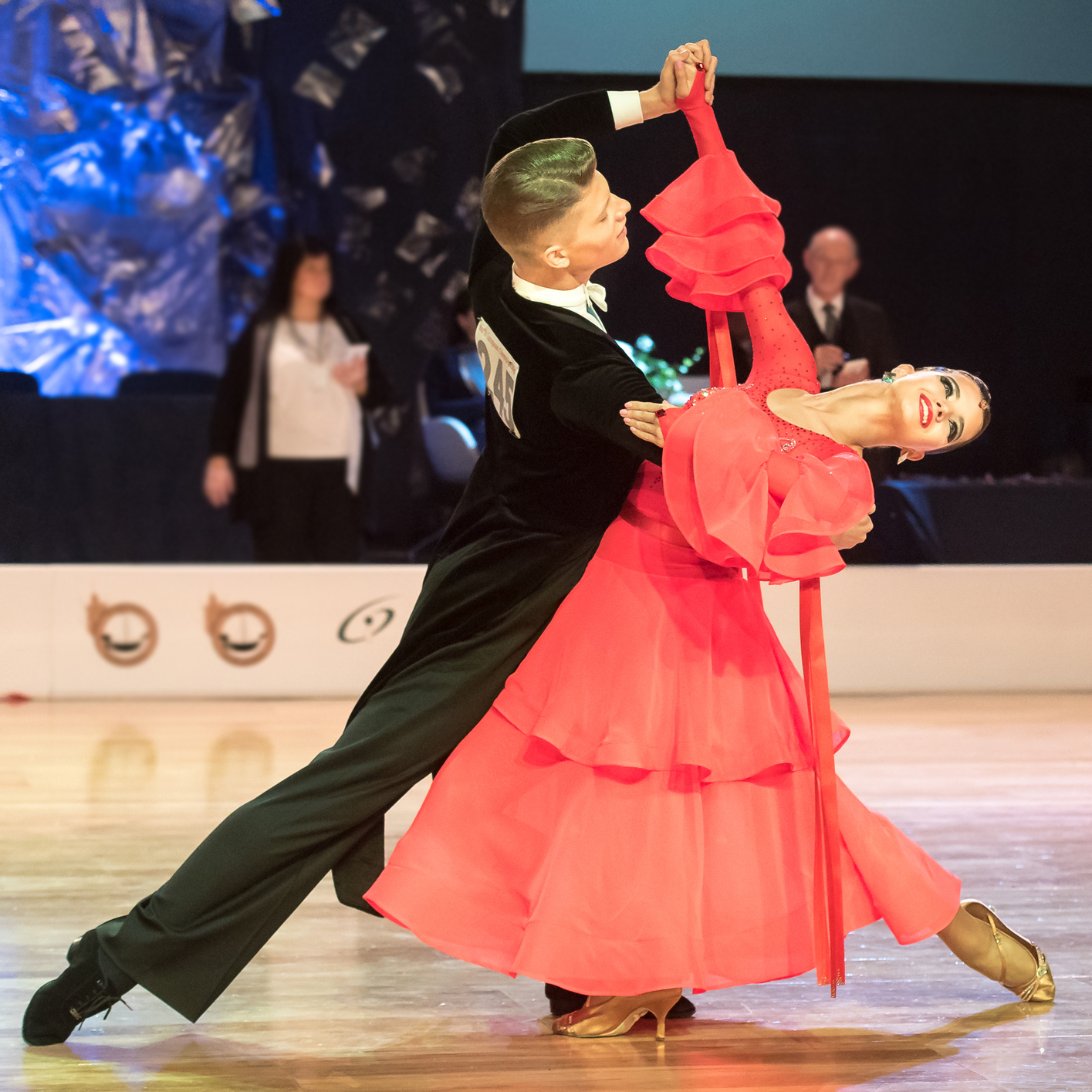 A competitive ballroom couple performing an oversway figure.