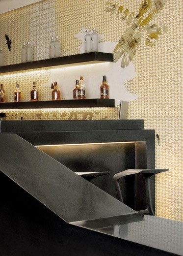 A custom-made black Corian bar counter.