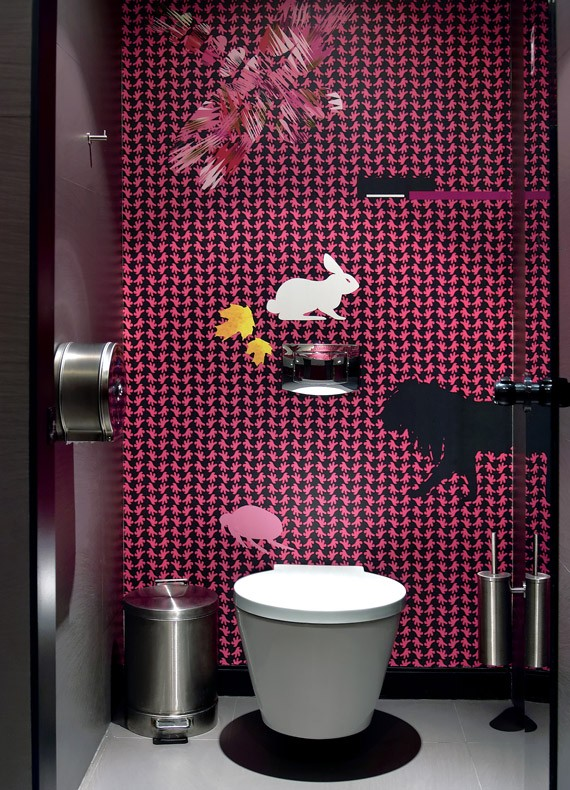 A feature wall in a restaurant WC with bold fuchsia and black custom wallpaper by Reform.